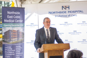 Doug MacDonald, vice president of planning for Northside Hospital, addresses the crowd at the groundbreaking of the new East Cobb Medical Center
