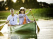 active adult couple in canoe